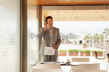 young business man standing in cafe