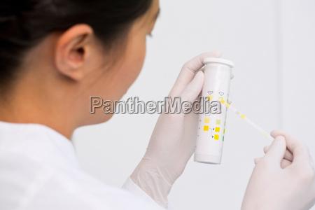 female scientist testing urine sample