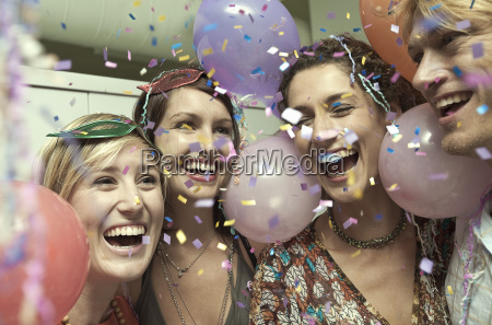 young adult friends celebrating at party