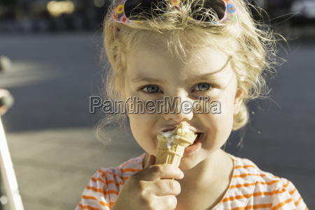 close up of girl eating ice