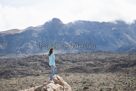 mid adult woman standing on rock