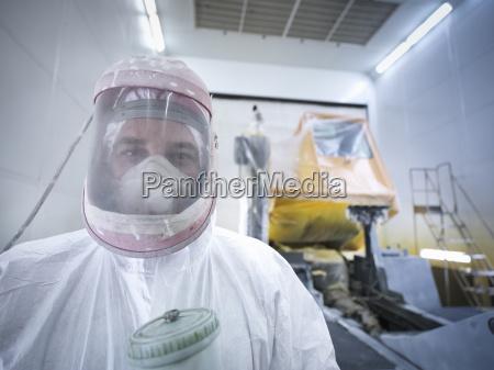 portrait of paint spray technician in
