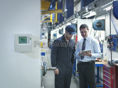 factory and office worker discussing energy