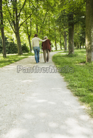 senior woman and granddaughter walking through