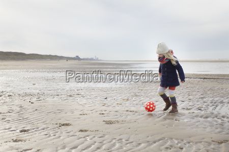 three year old girl playing football