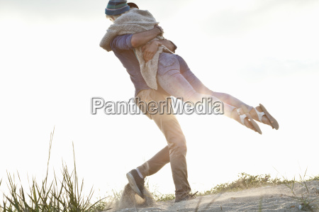 young couple hugging on bournemouth beach