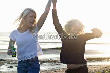 mother and daughter dancing on bournemouth