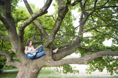mid adult woman sitting in woodland