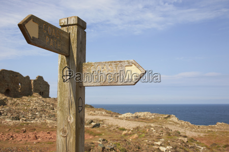 sign post and tin mine ruins