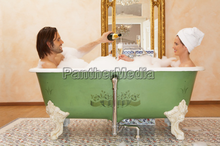 young couple sitting in bath