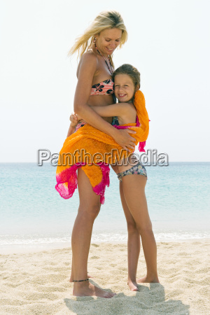 woman and young girl embracing