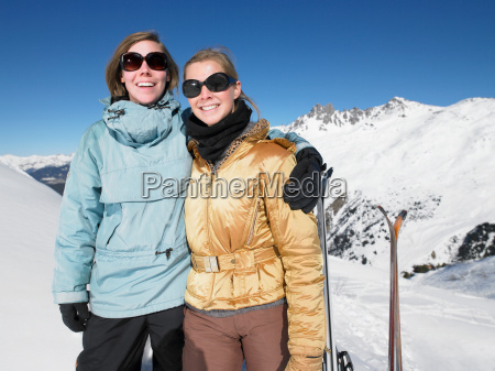 smiling young women on mountain top