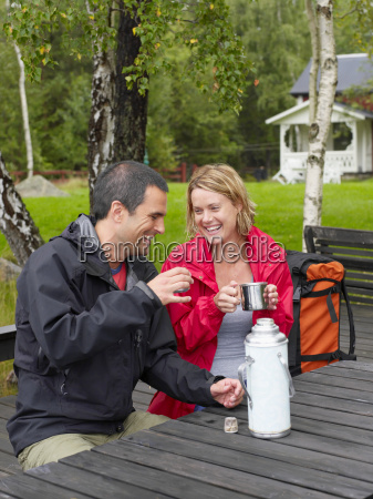couple sitting in a park with