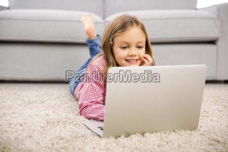 little girl making homework