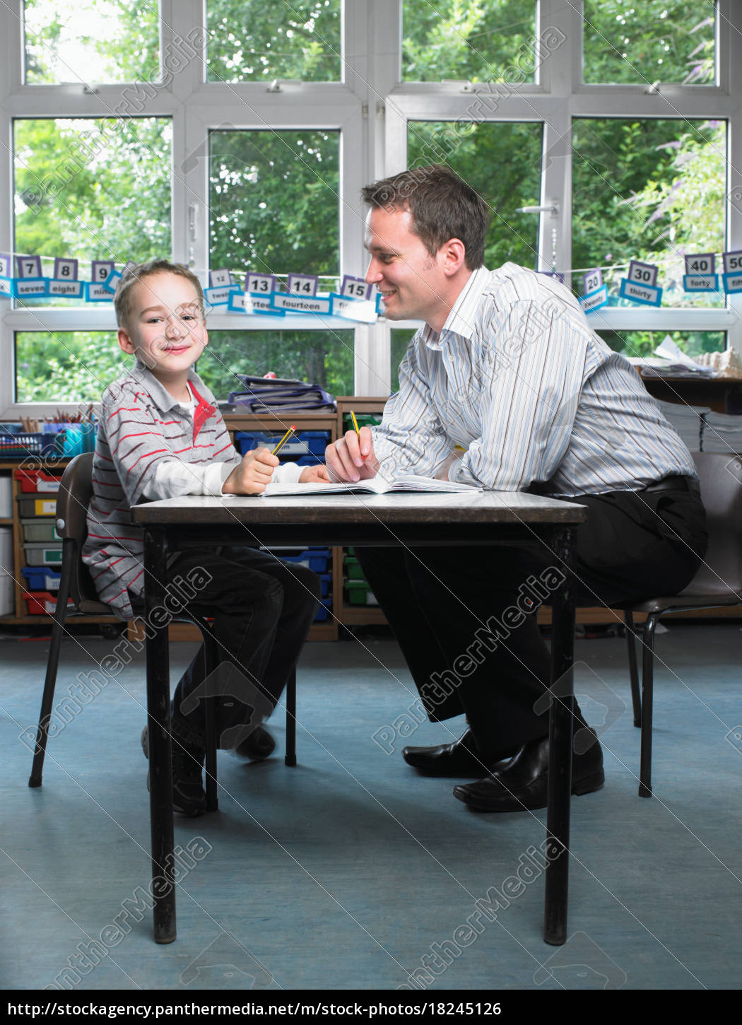 male, teacher, helping, young, boy, with - 18245126