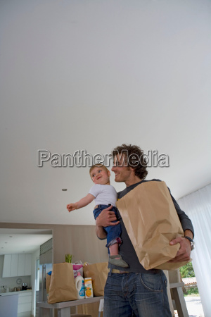 happy father with baby shopping