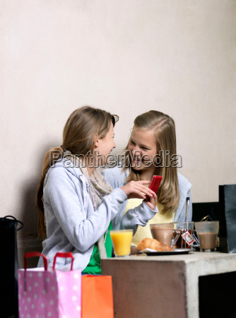 two girls using cell phone