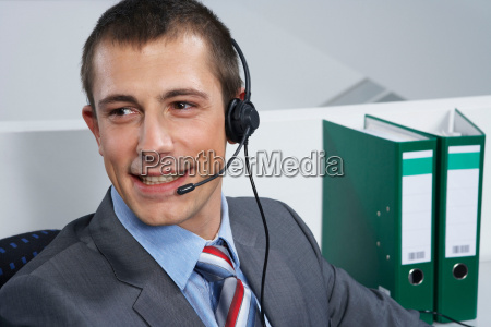 man with headset smiling portrait