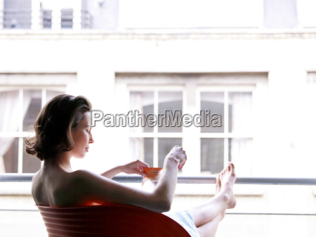 woman sitting at window with a