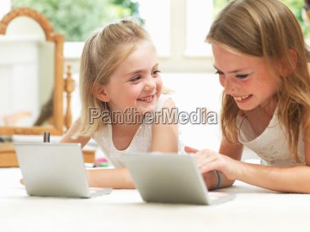 girls smiling putting on make up
