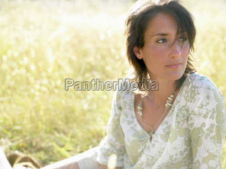 woman sitting in a field