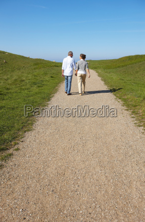 mature couple walking away together