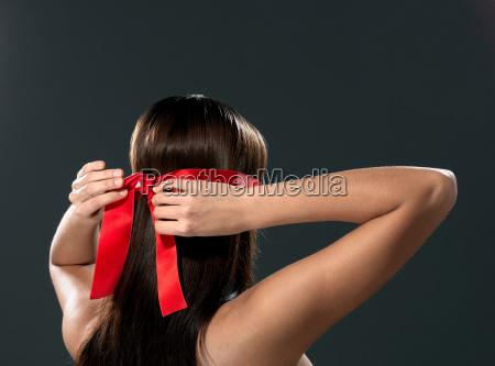 woman with eye ribbon