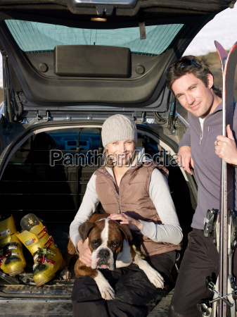man and woman in car with