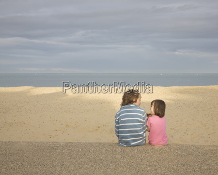 boy and girl sitting on promenade