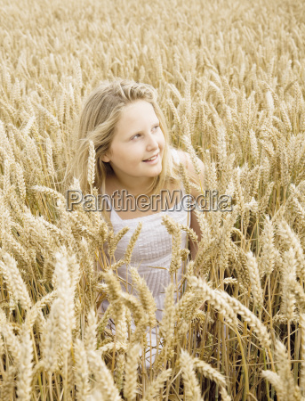 girl hiding in wheat field