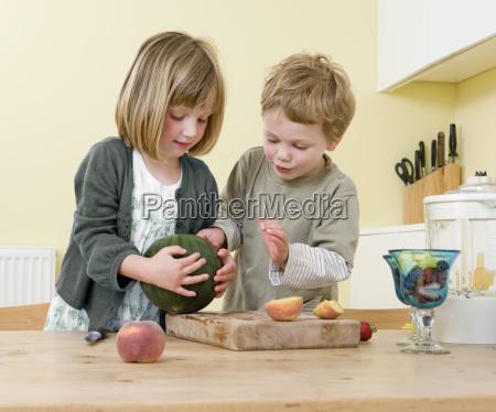 boy and girl preparing fruit