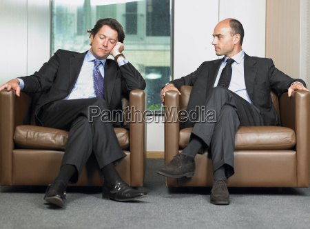 business men in a waiting room