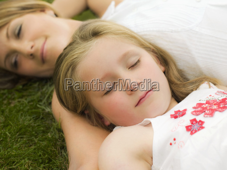 a mother and daughter lying on