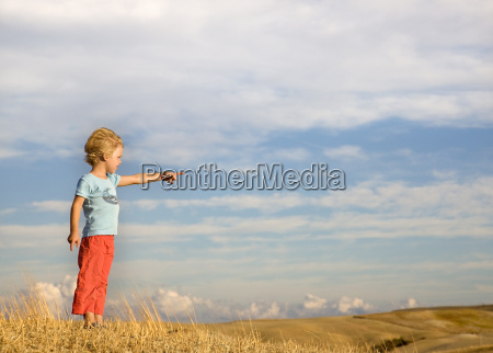 boy pointing into distance