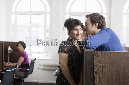 couple flirting in business center