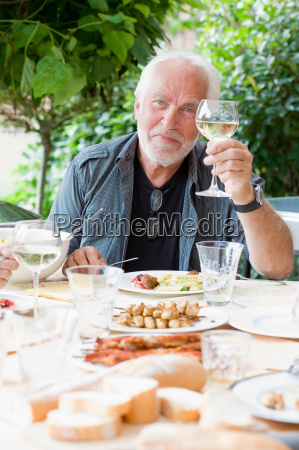 man at table with food
