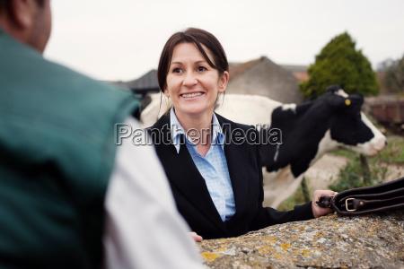 business woman talking to farmer