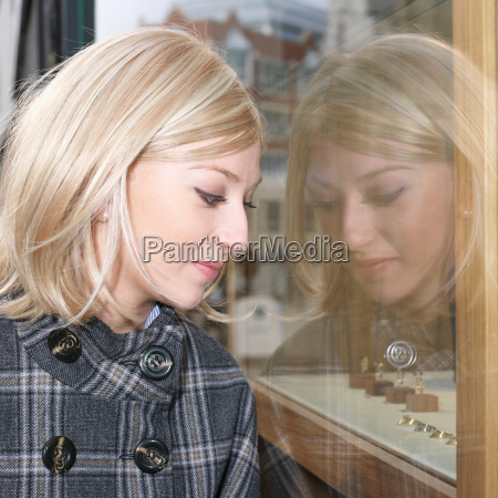 woman looking at shop window