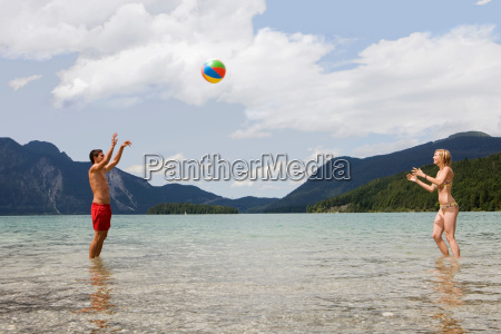a young couple playing with a