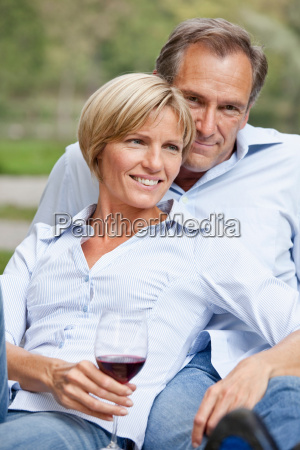 middle aged couple sitting close