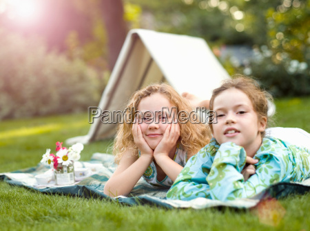 two girls smiling at play picnic
