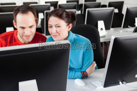 couple sitting together in lecture hall