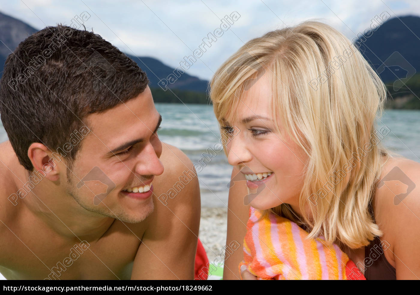 a, young, couple, smiling, at, each - 18249662