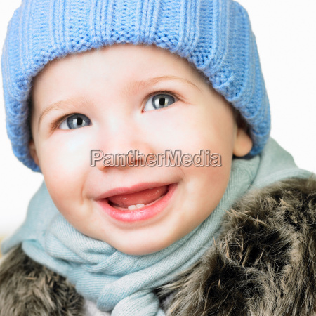 baby girl with a hat smiling