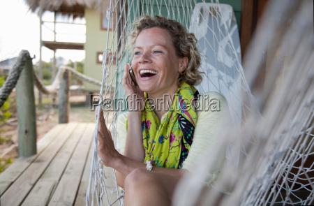 woman in a hammock talking on