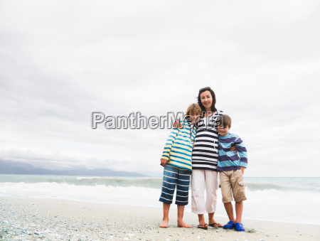 woman and two boys on a