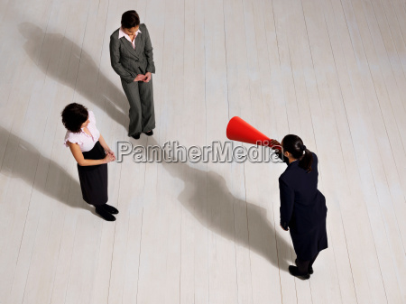 business woman shouting at women