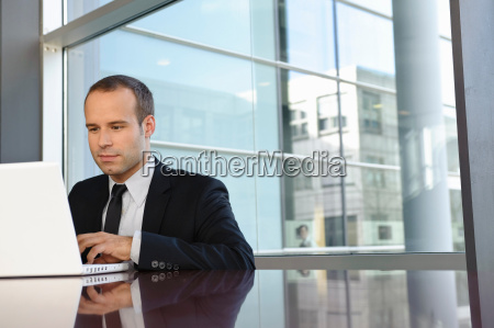 business man is working with laptop