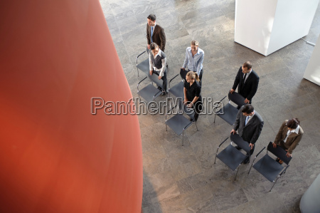 group of business people with chairs