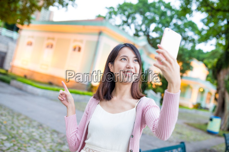 young woman taking image by mobile